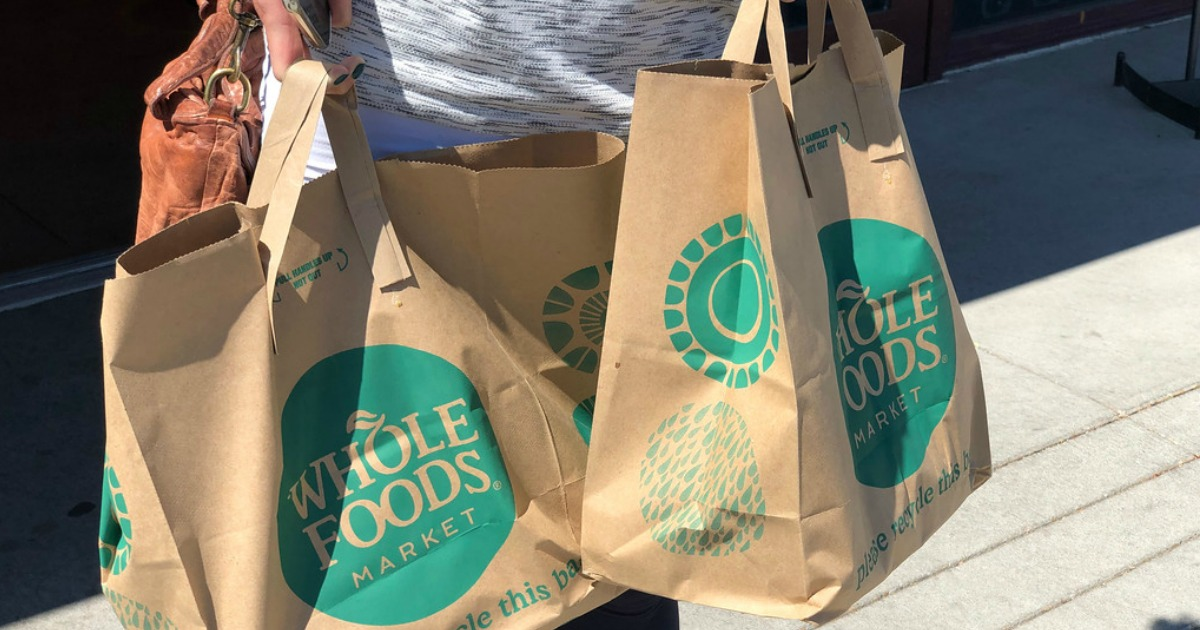 Collin holding whole foods grocery bags