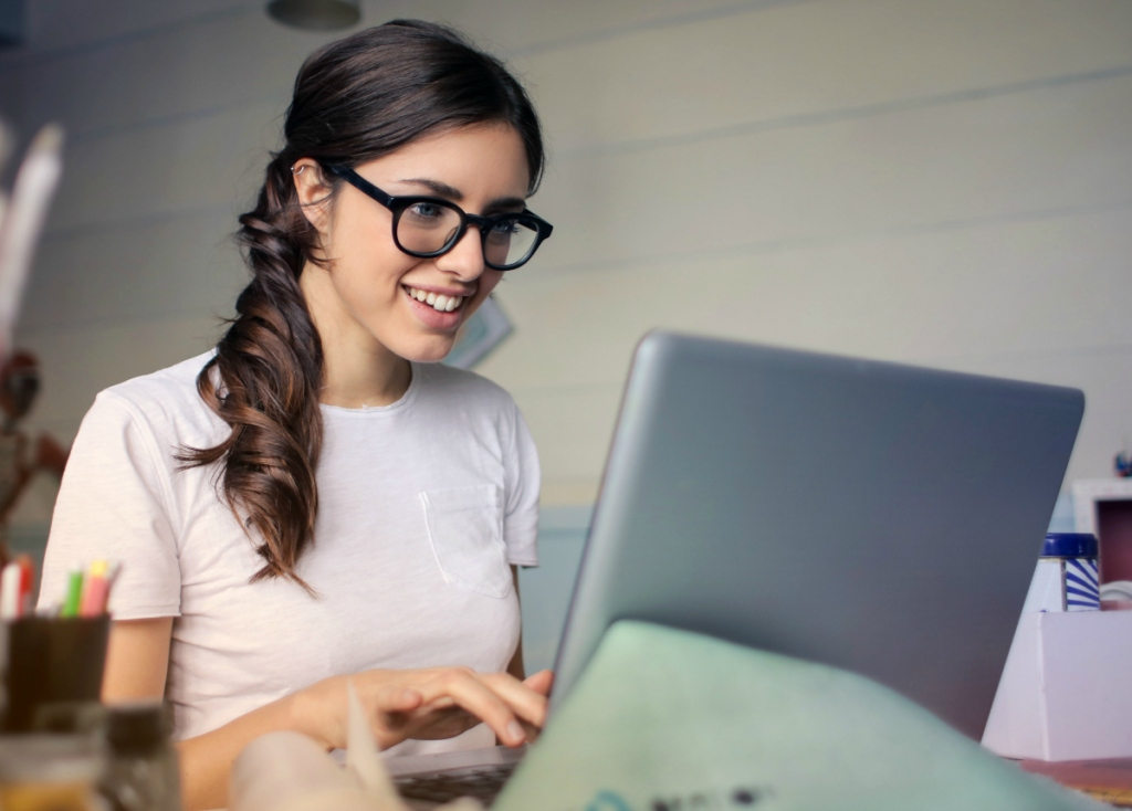 woman sitting at laptop