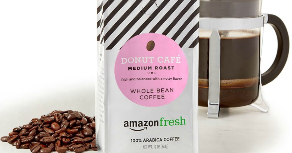 AmazonFresh Donut Cafe Whole Bean Coffee with whole coffee bean and coffee press in background