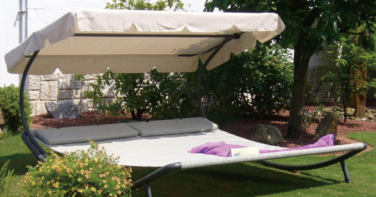giant lounger with beige canopy outdoors
