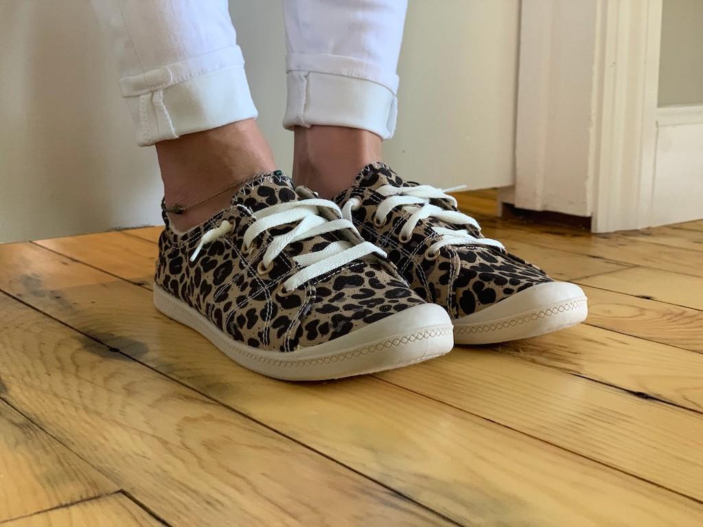 woman wearing leopard print canvas sneakers