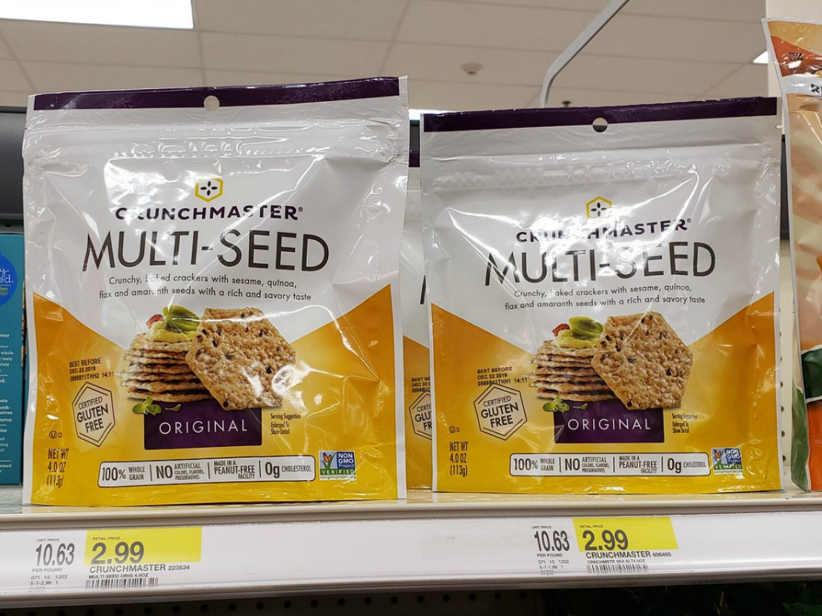 bags of crunchmaster multi-seed crackers sitting on a Target store shelf