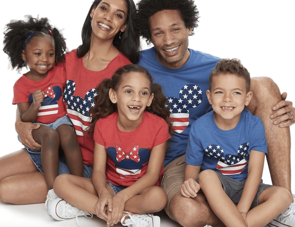 family wearing matching Disney Tees