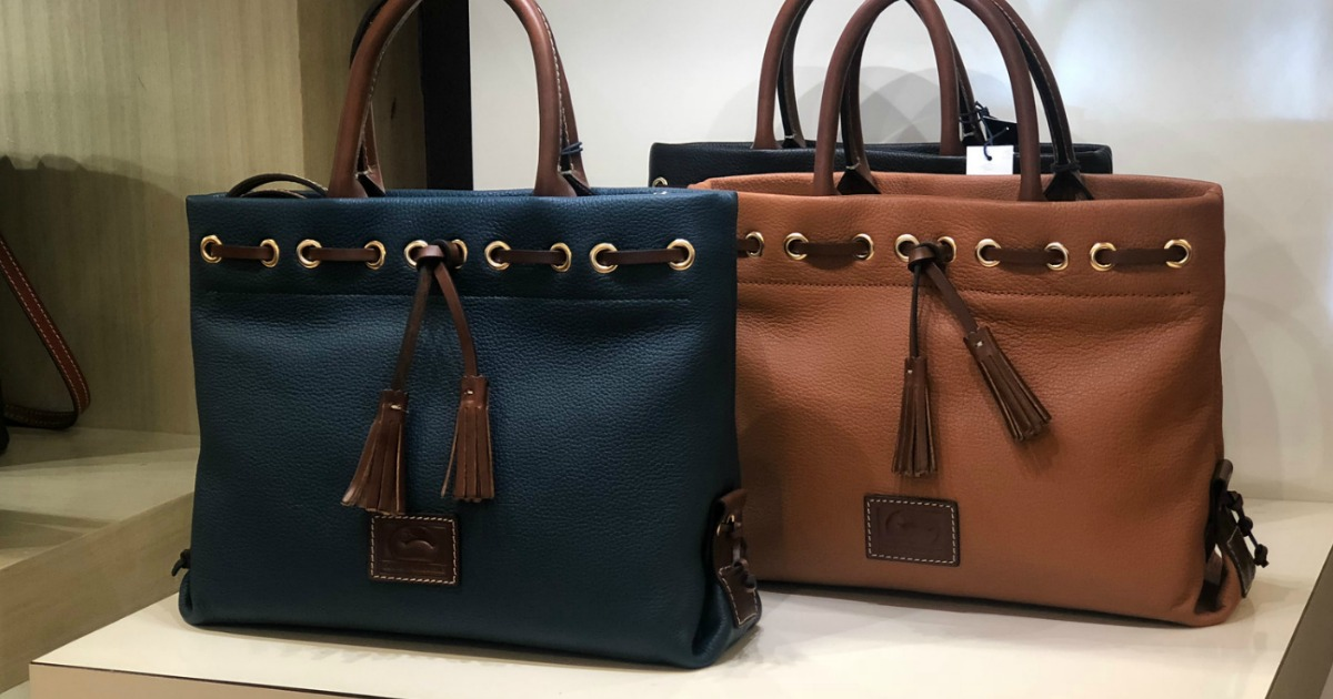 Dooney Bourke Wakefield Totes on store counter