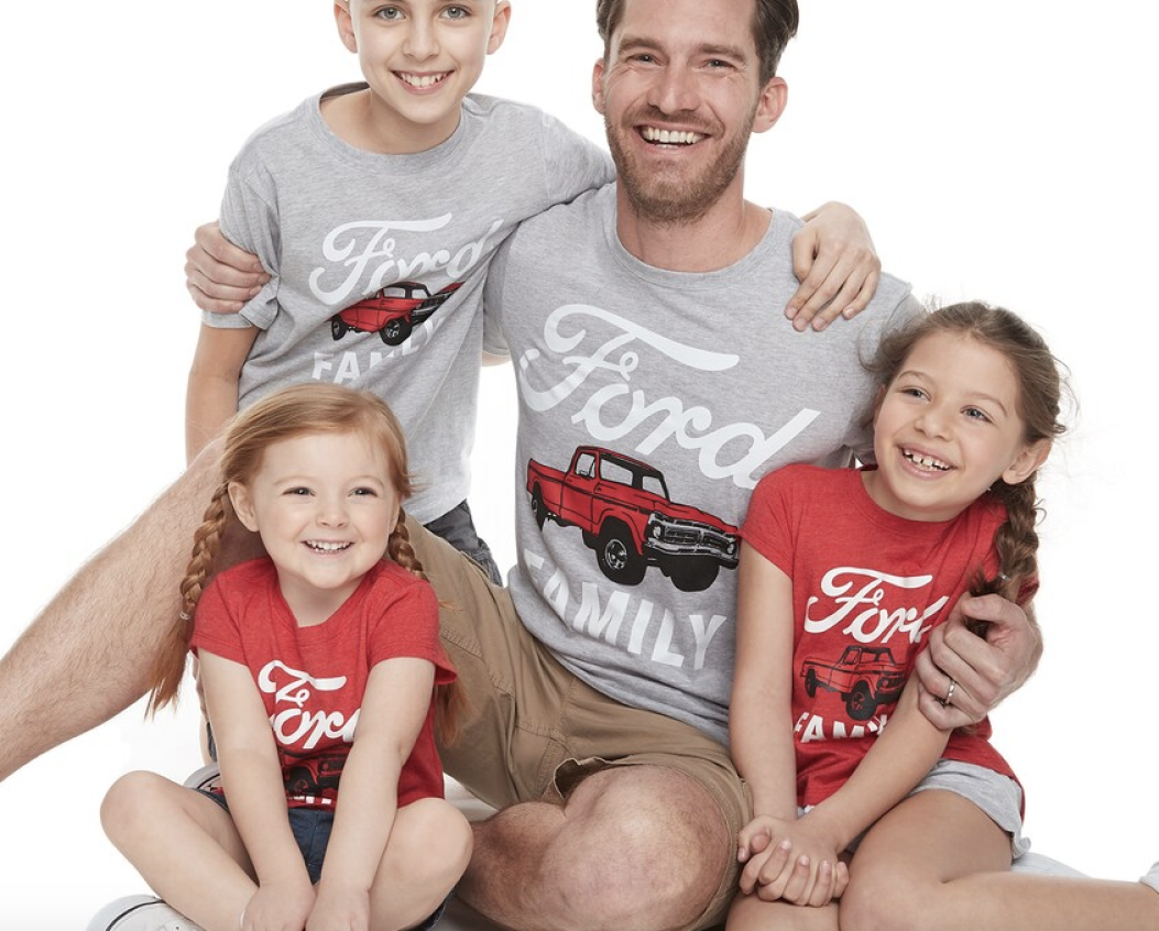 Dad and kids wearing matching Ford tees from Kohl's
