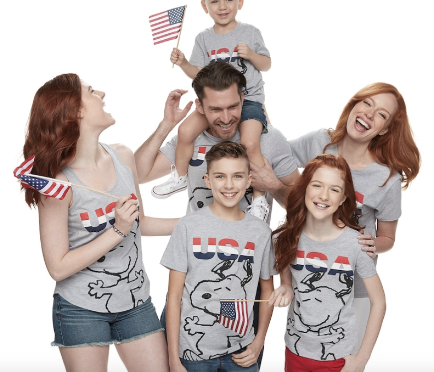 Family wearing matching Peanuts and Snoopy patriotic tees from Kohl's