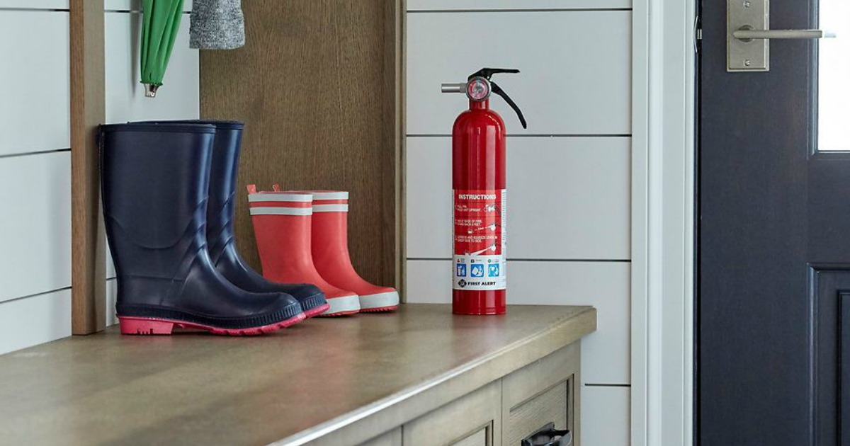 fire extinguisher on table with rain boots