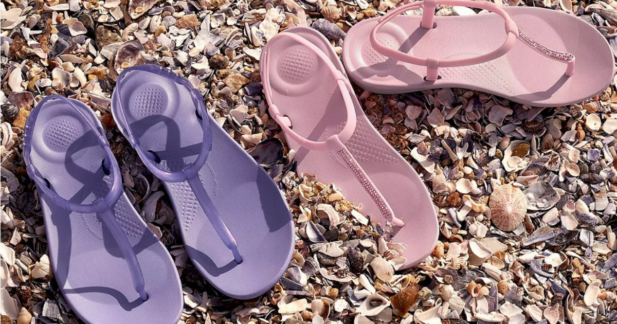 pink and purple FitFlop sandals on seashells
