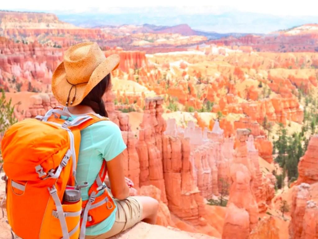 Girl sitting looking at Grand Canyon