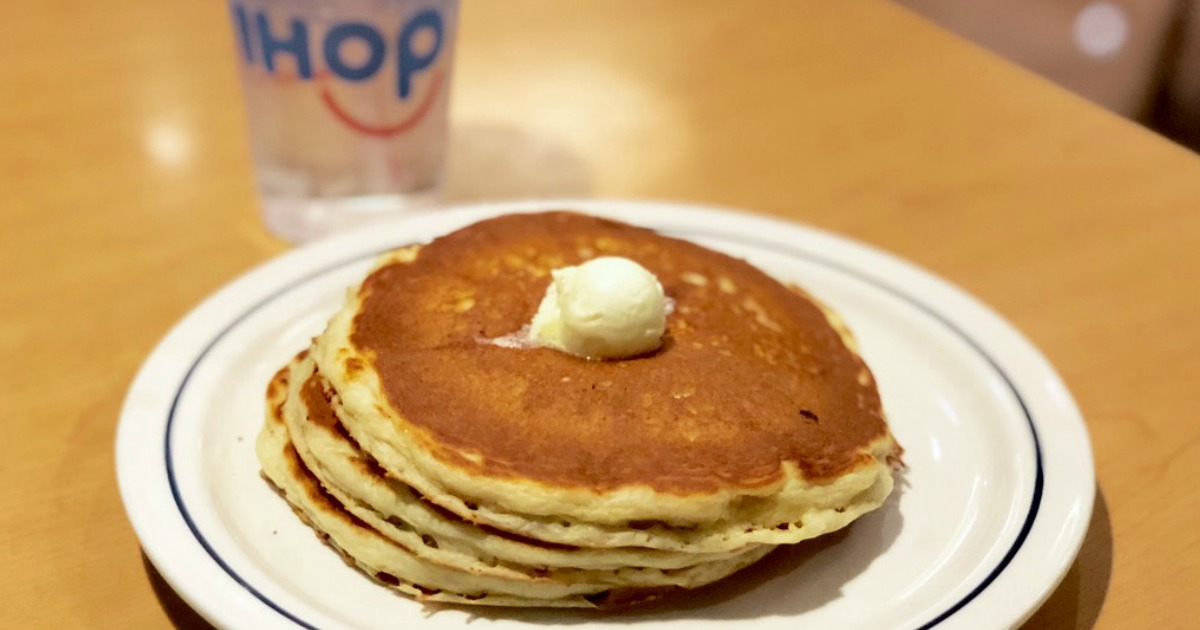Plated Stack of buttermilk pancakes with scoop of butter at IHOP restaurant