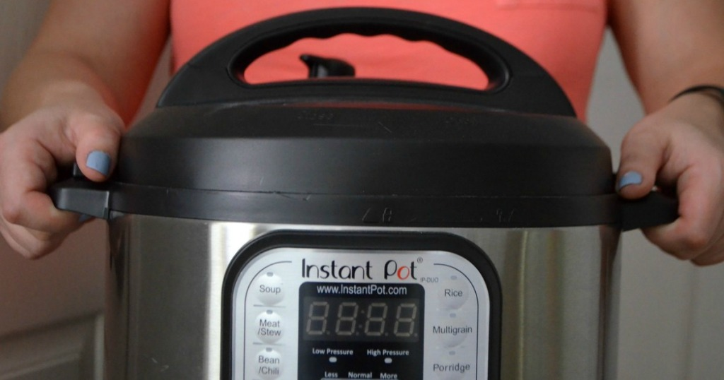 woman holding an instant pot pressure cooker