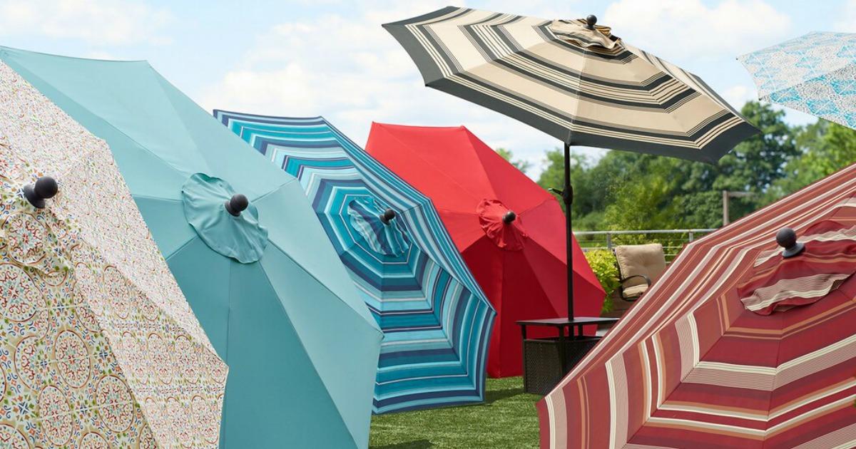 Variety of Sonoma Patio Umbrellas in a backyard