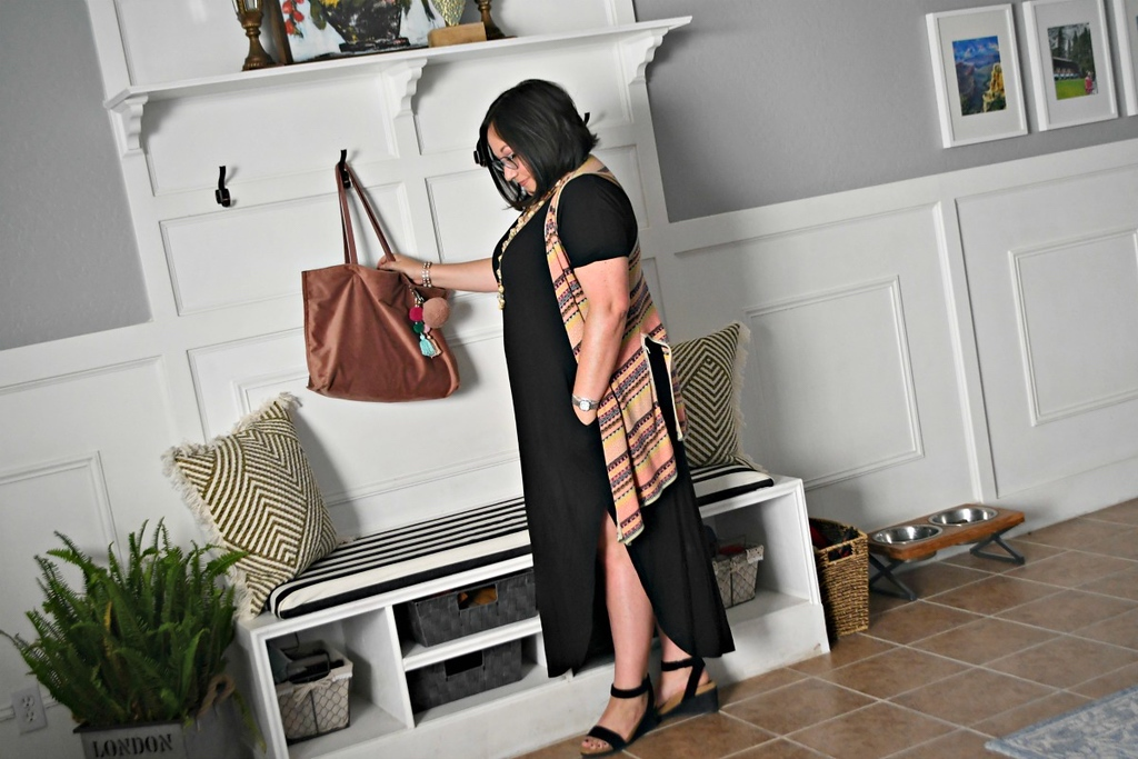 Lina wearing black Maxi dress with vest