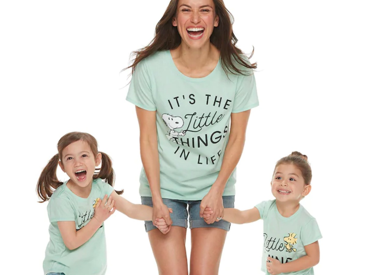 Mom holding hands with two small kids wearing matching mommy & me tees from Kohl's