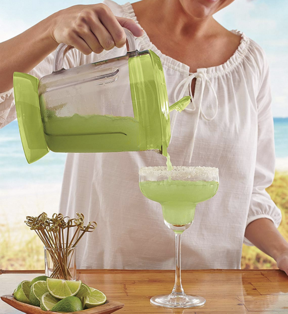 Woman making drink with Margaritaville Bahamas Frozen Concoction Maker
