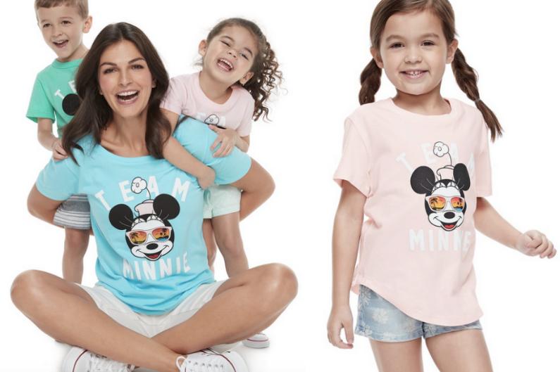 woman and three kids wearing matching Disney tees