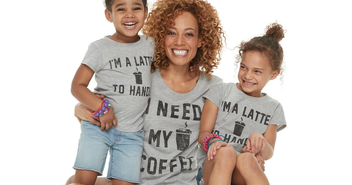 Mom hugging two small kids wearing matching mommy & me tees from Kohl's