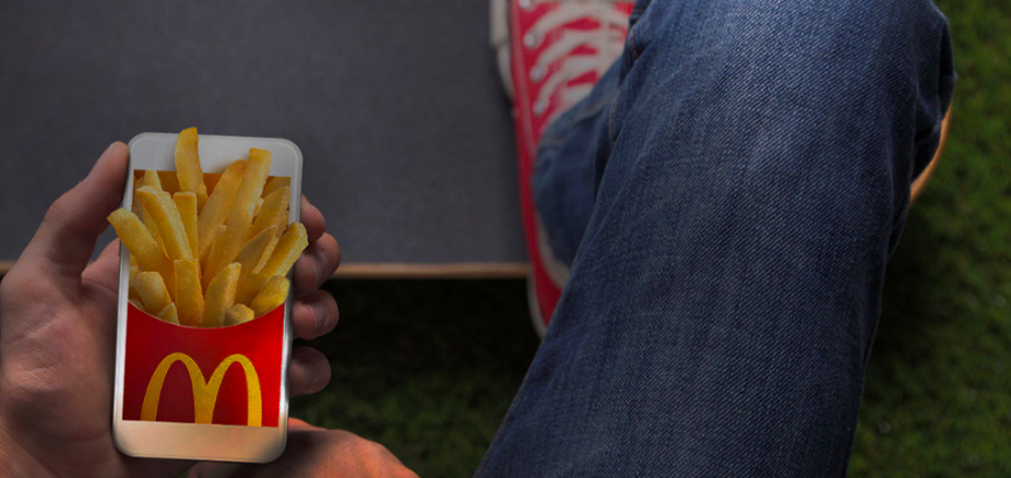 McDonalds app showing fries bursting from the screen