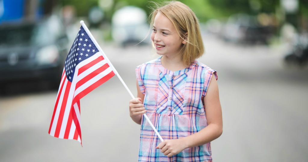 Piper holding American flag
