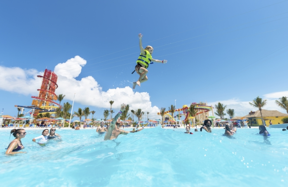 a kid in a wave pool wearing a flotation device at CocoCay