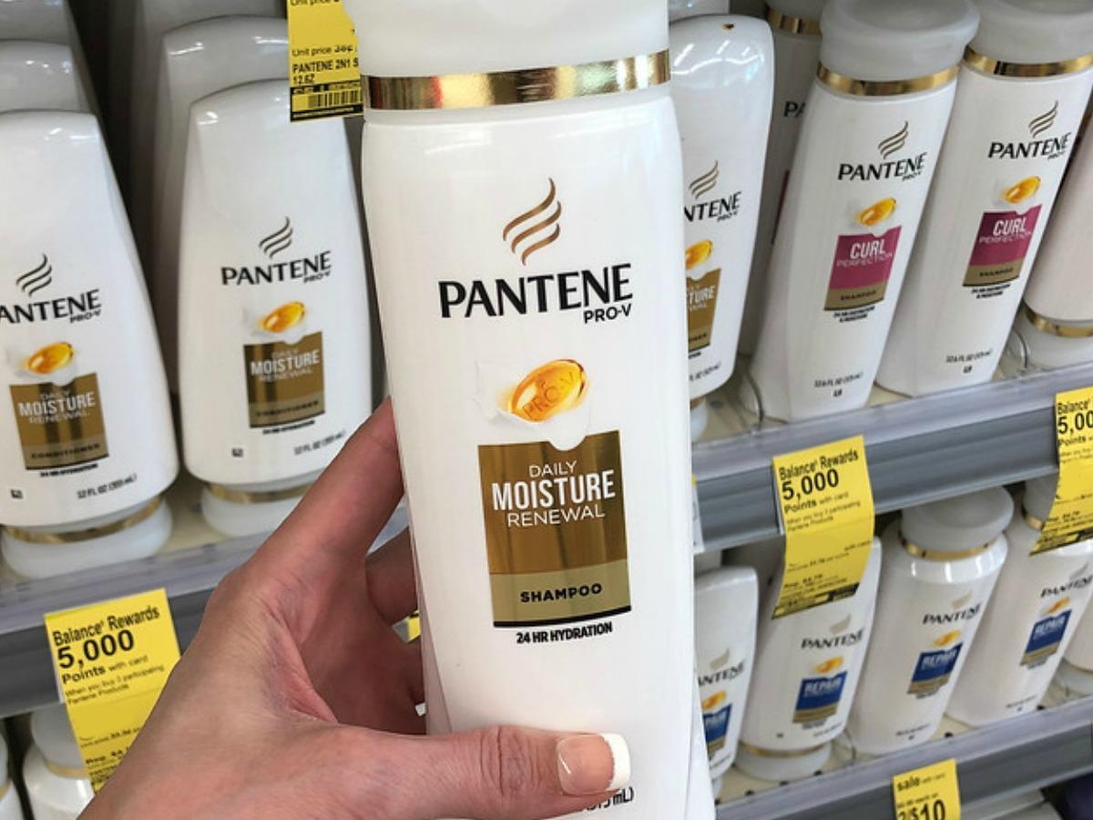 Woman holding Pantene Shampoo at Walgreens