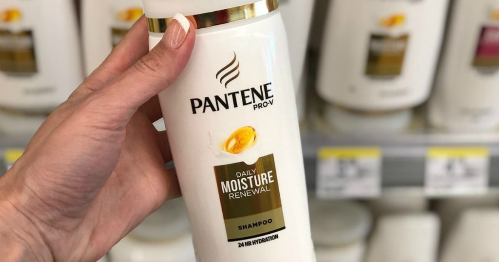 Woman's Hand holding Pantene Shampoo with blurred Walgreens Background