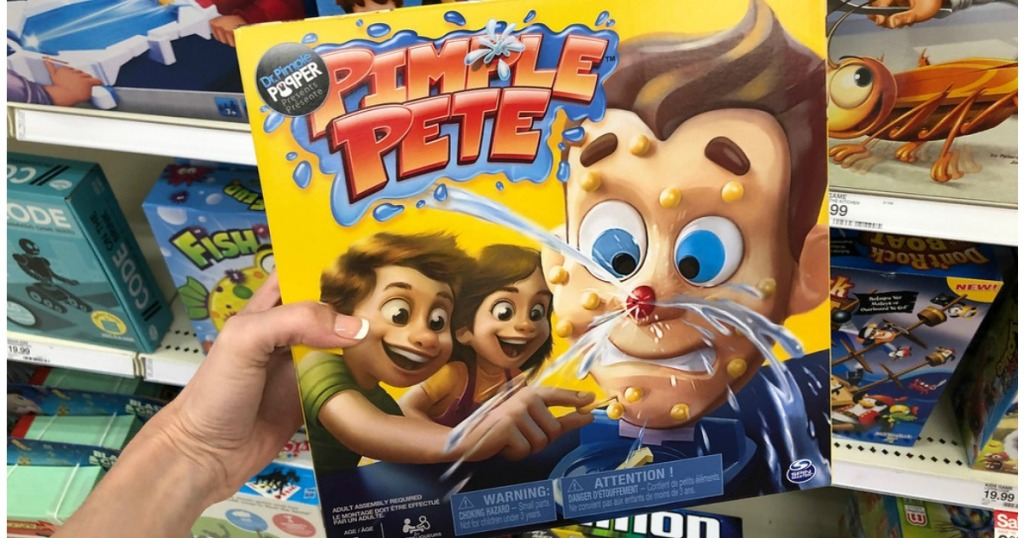 Pimple Pete Board Game being held by woman's hand