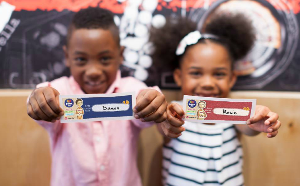 Pizza Hut Book It Summer Reading Program - kids holding out name tags
