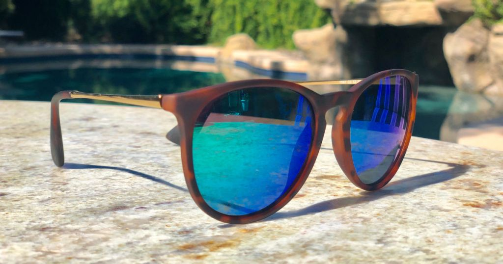 brown sunglasses with colored lenses on patio