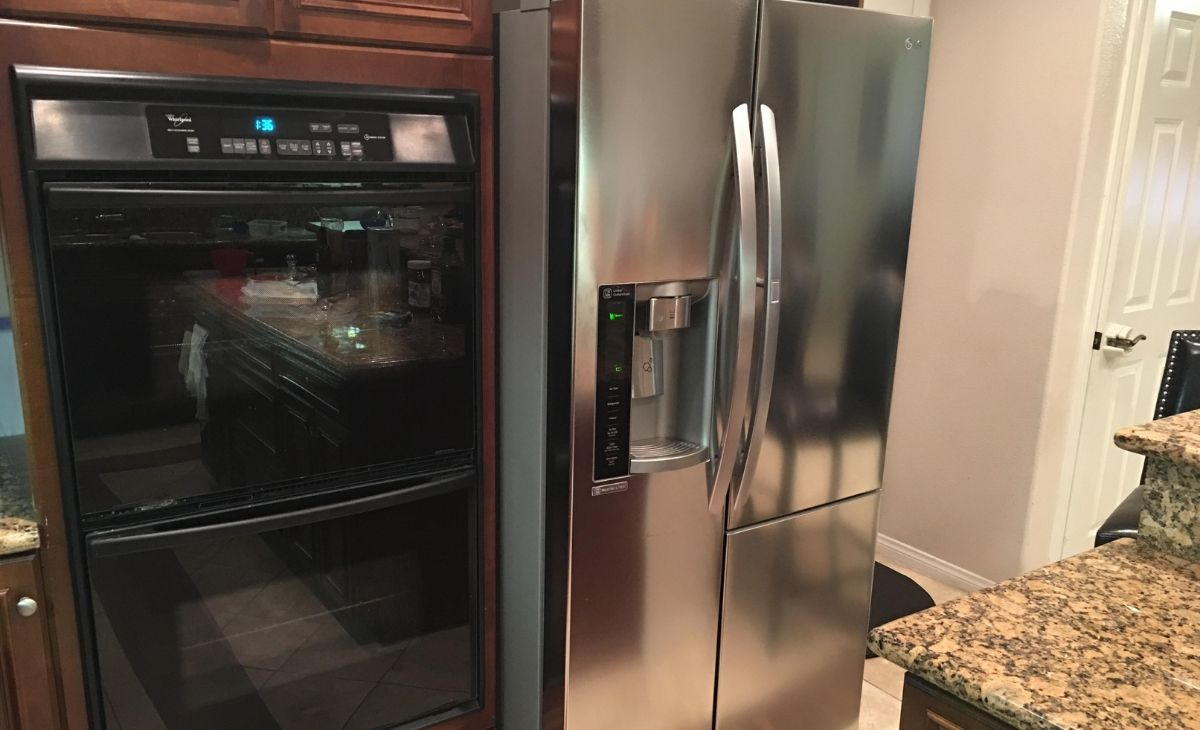 LG side-by-side refrigerator in a kitchen