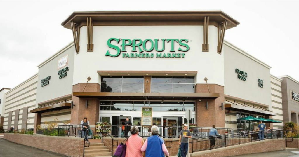 store front of sprouts farmers market with people walking in and out of the building