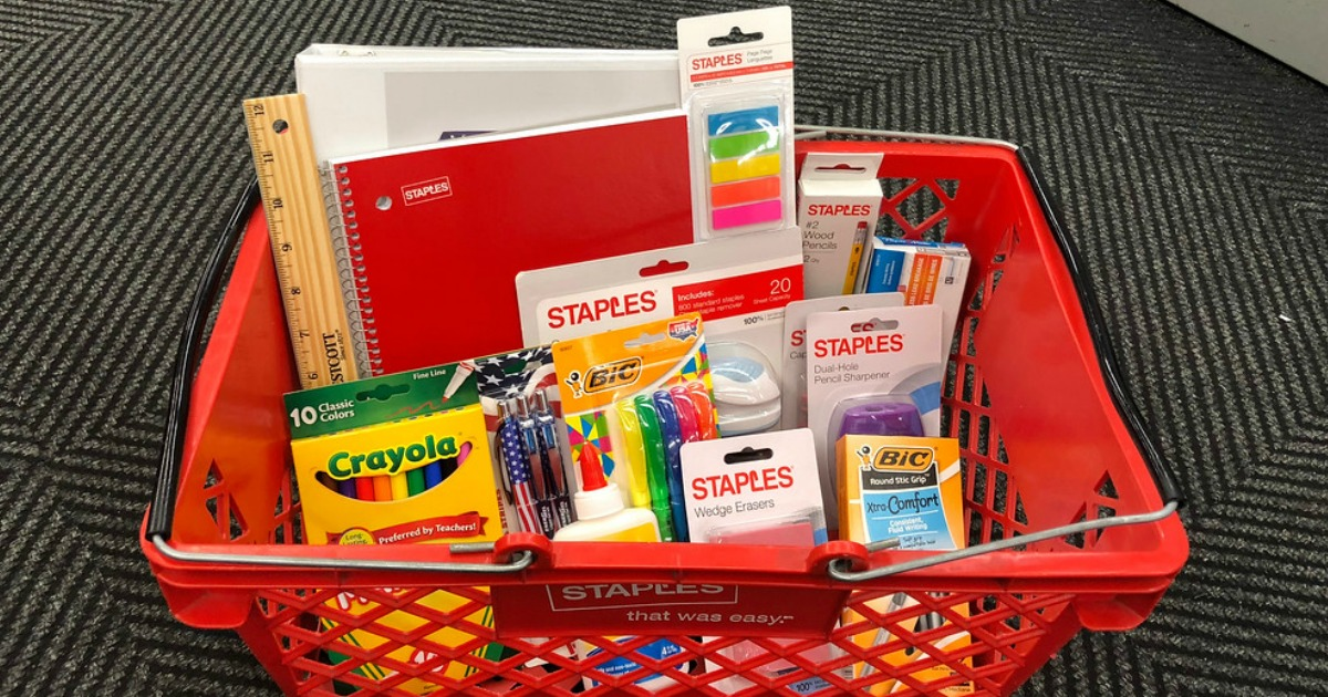 staples back to school supplies in a red staples basket on the floor