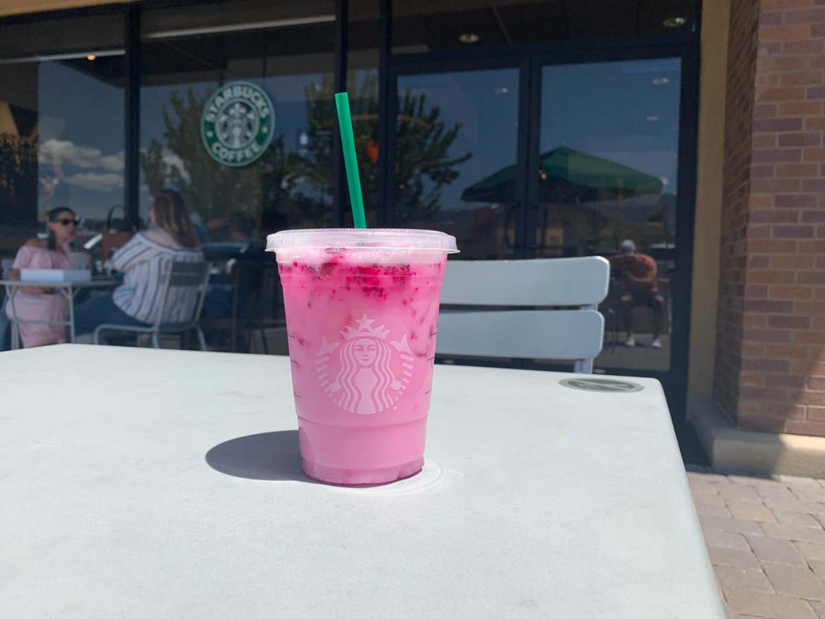 starbucks dragon refresher in front of store on a table