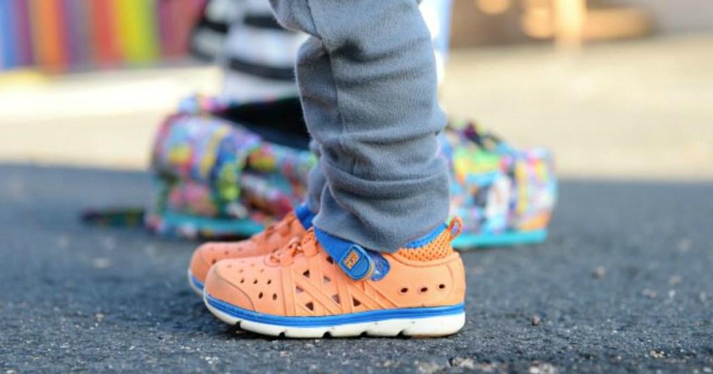 Stride Rite Orange Made2Play Phibian Sneaker Sandals on kid