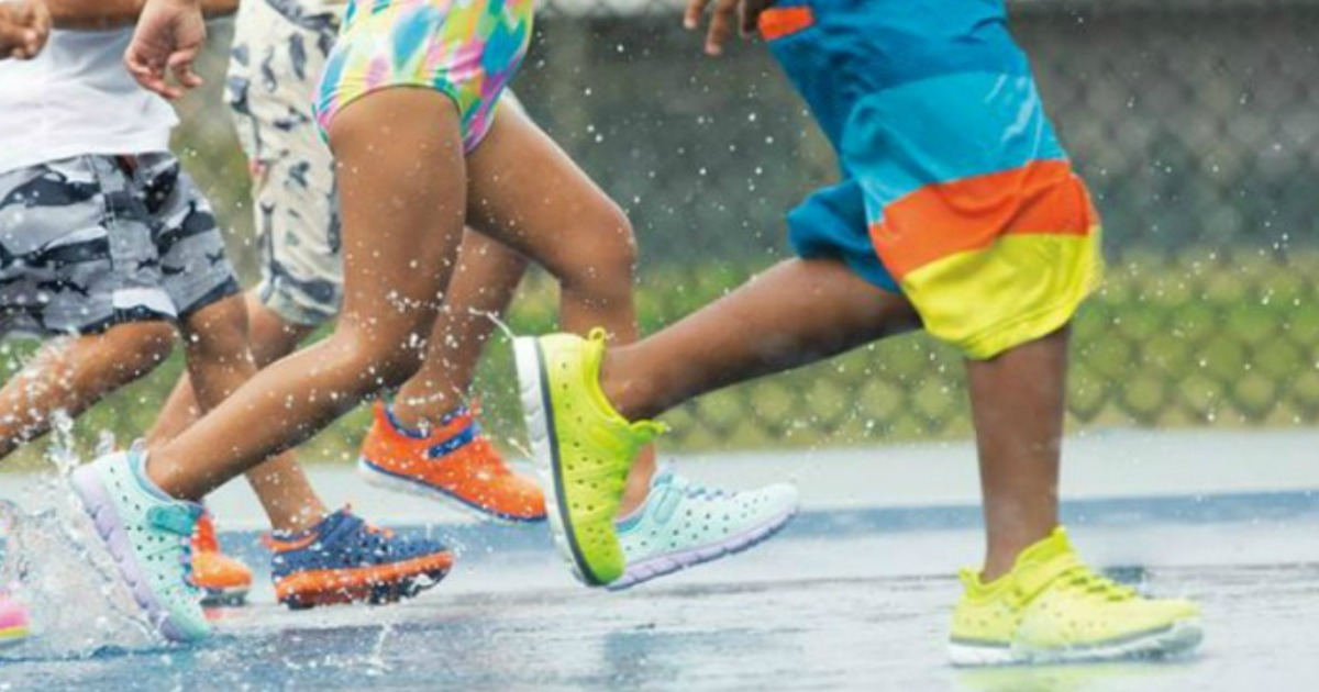 kids playing in the water wearing Stride Rite Made 2 Play Phibian Water Shoes