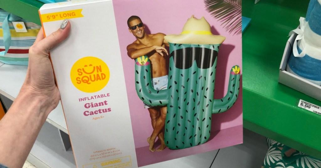 holding Sun Squad giant cactus pool float
