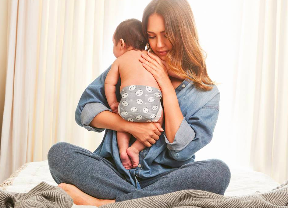 The Honest Company Panda Diapers on a baby hugged by mom