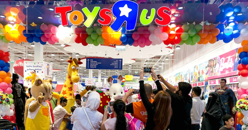 ToysRUs store front with people