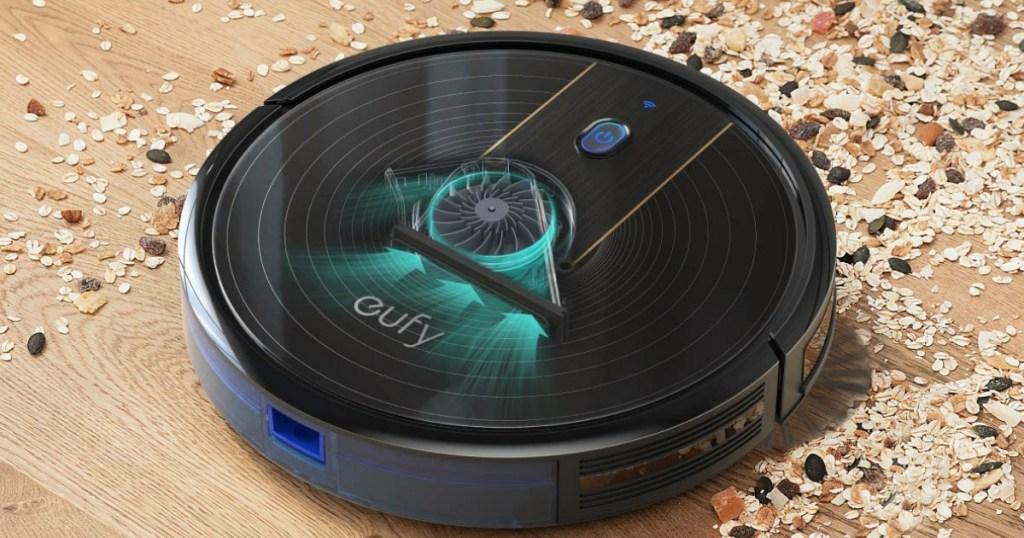 eufy BoostIQ RoboVac 11S (Slim), Robot Vacuum on the floor cleaning spilt oatmeal
