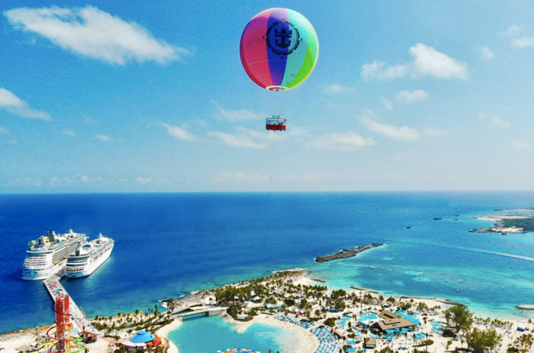 a rainbow-colored helium balloon over CocoCay