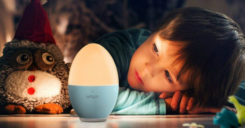 little boy looking at the VAVA Kids Rechargeable Nightlight