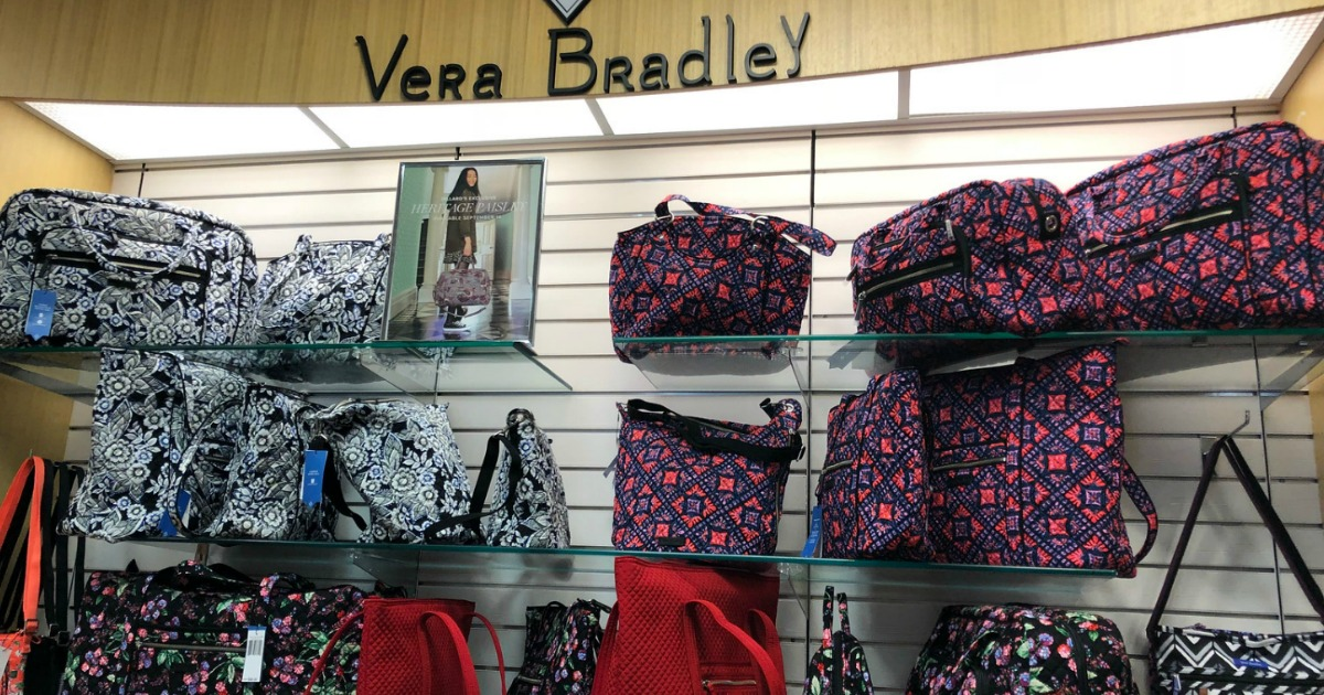 Vera Bradley assorted bags, on glass shelving in store
