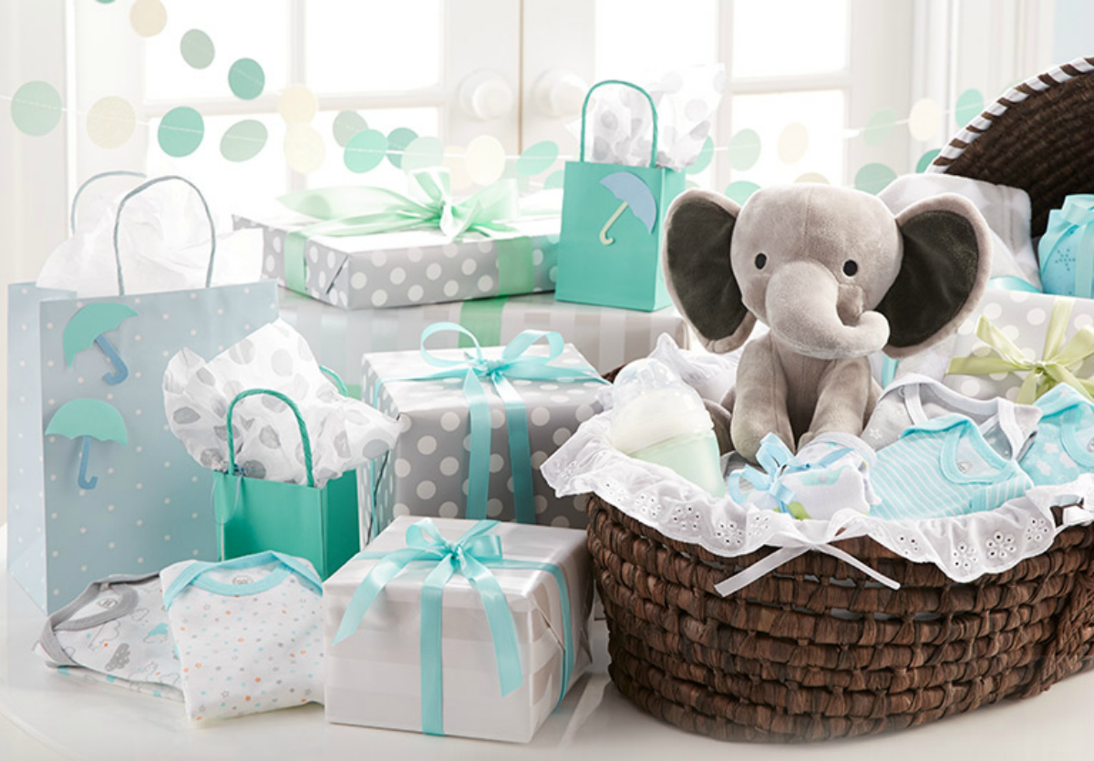 baby gifts wrapped in grey and aqua wrapping paper
