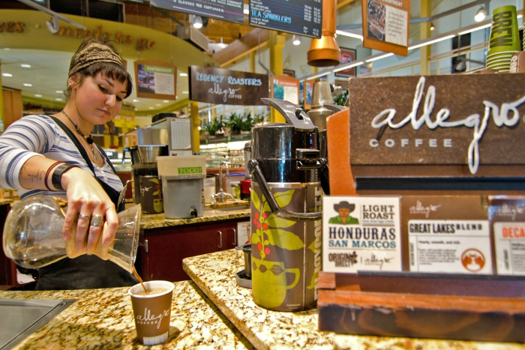 woman pouring Allegro coffee at Whole Foods Market