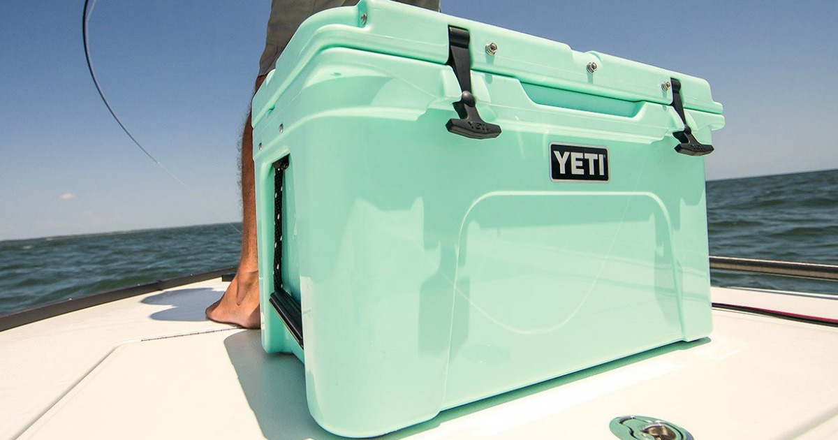 yeti 45 tundra cooler on the front end of a boat in the ocean