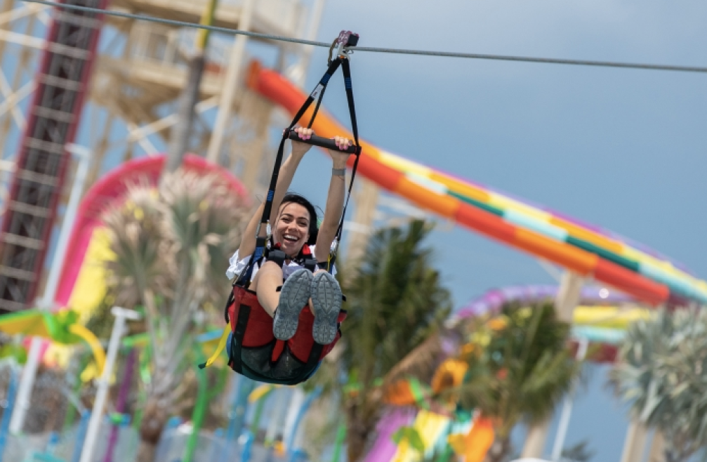 a woman riding a zip line at CocoCay