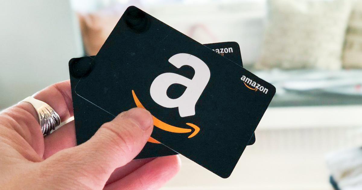 holding up 2 amazon gift cards