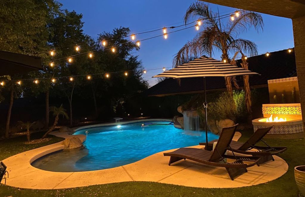backyard with pool fire pit and string lights - selling your home