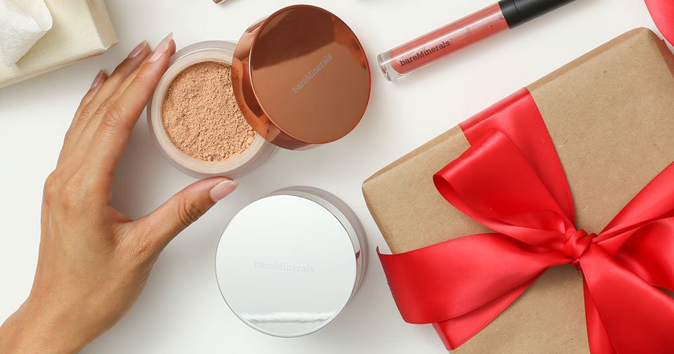 open bareMinerals powder plus a package with a red bow