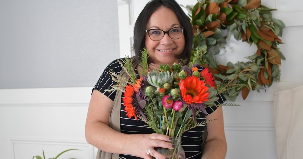 woman holding colorful bouquet of flowers